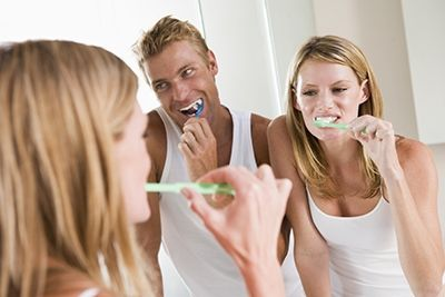 Small Couple Brushing Teeth Bathroom Water Fluoride
