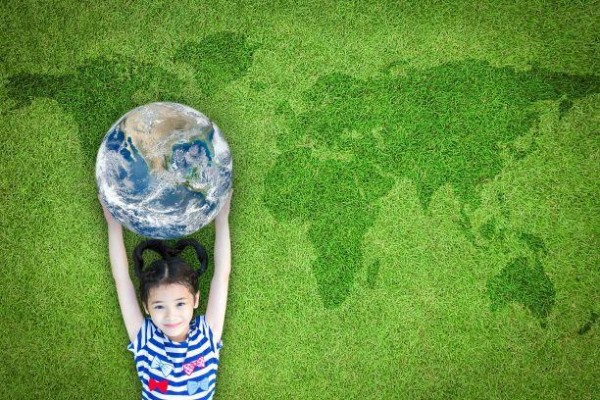 Little girl holding globe environmental